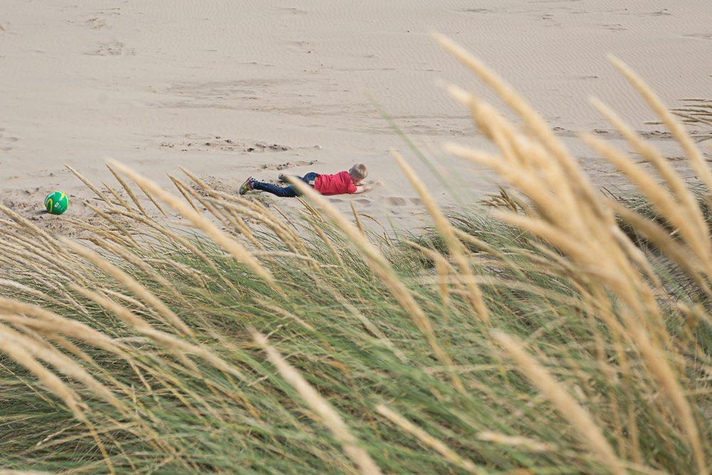 Boy on beach with his dog