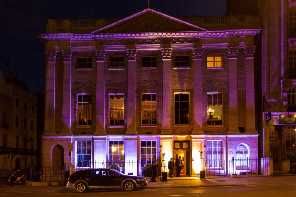 Night time photograph of Mayfair Club with purple lighting