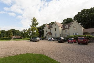Country hotel with cars outside